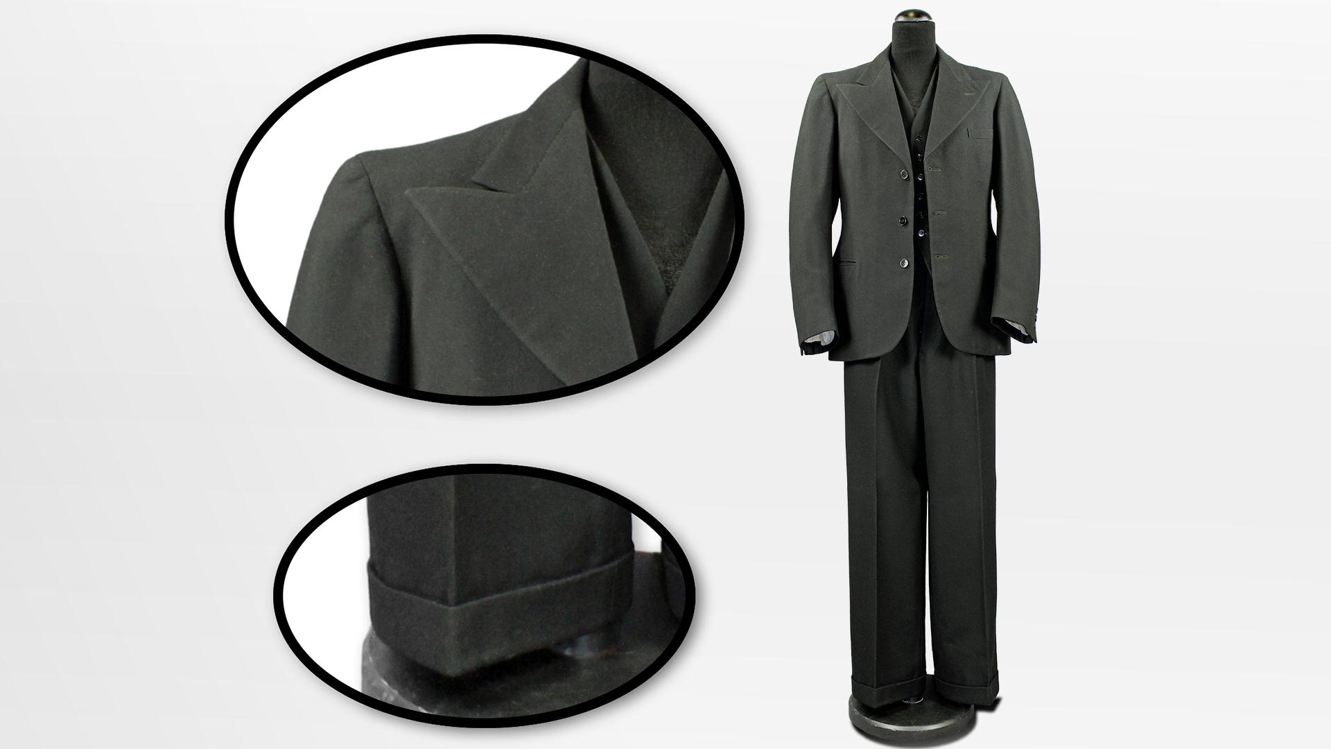 23ea9c2fea83 Sven Hellmans kostym har breda spetsiga slag, tydligt markerad midja och  vida byxor med slag nedtill. Det betyder att den är mer trendig än Edvins  och Pauls ...